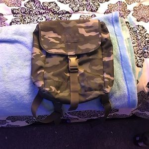 I'm selling a camouflage mini backpack